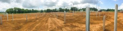 The metal posts pictured above will be the base for the racking and panels as ARiES and AEC continue the solar project.