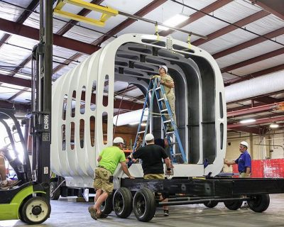 "The plastic ""ribs"" that form the frame of the mobile home were made via 3D printing and additive manufacturing. (Credit: Curbed)"